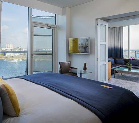 voco Signature Suite with waterfront view and private balcony