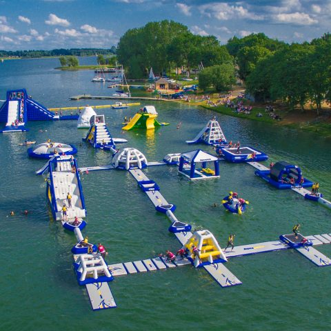 Floating Aqua Park with trampolines, slides and monkey bars